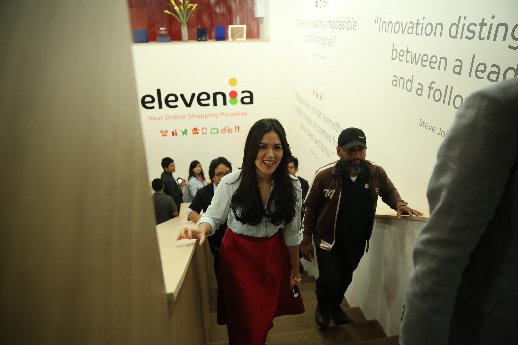 Raisa walking up the steps at elevenia office.